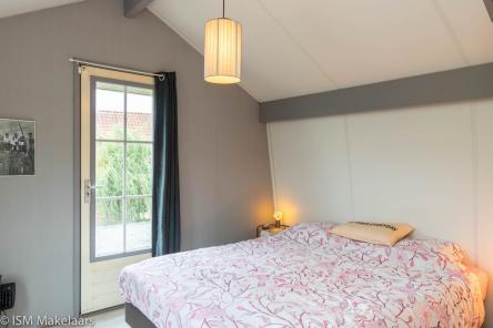 slaapkamer zijkant molendijk 7 wolphaartsdijk ism makelaars