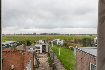 uitzicht slaapkamer Veerweg 11 Wolphaartsdijk ism makelaars
